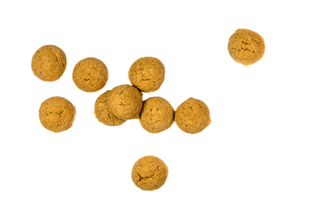 Quantity of scattered Pepernoten cookies from above as Sinterklaas decoration on white background for dutch sinterklaasfeest holiday event on december 5th Stock Photo