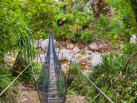 Metal Swingbridge on the Heaphy Track in Kahurangi National Park on the West Coast of New  Zealand