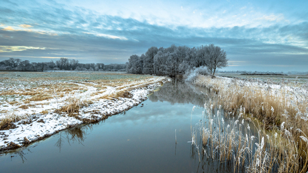Frozen river Drentsche Aa in the province of Drenthe in the Netherlands on a cold morning