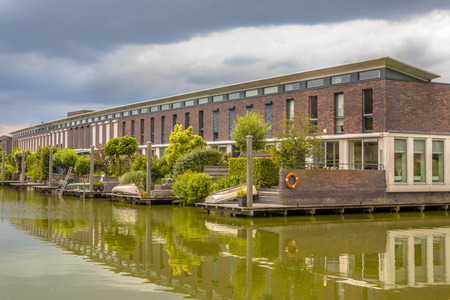 Modern houses with  hanging terrace gardens on waterfront in urban area of The Hague, Netherlands Stock Photo
