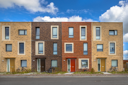 Four Modern Social housing in terra colors containing modest family apartment houses in Ypenburg, The Hague, Netherlands 免版税图像 - 94871458