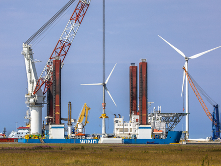 Offshore wind turbine supply vessel anchored and loading in port of Eemshaven, Netherlands Stok Fotoğraf