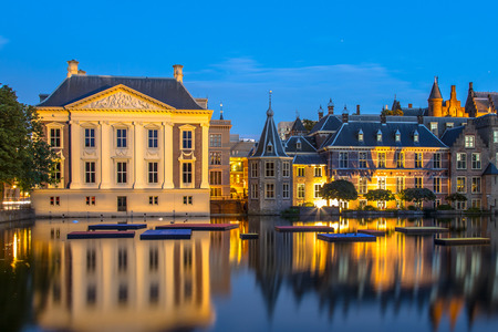 Dutch parliament building Binnenhof and Mauritshuis seen from Hofvijver at night. The Hague Netherlands