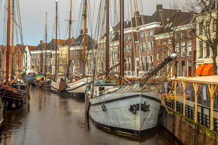 Historic sailing ships at the annual Winterwelvaart festival around christmas. reliving the old times on the old quays of Hoge der Aa in Groningen city Stock Photo