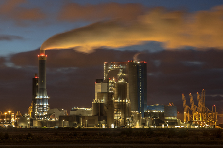 Coal powered electricity plant at night with illuminated smoke in Europoort, Maasvlakte Rotterdam