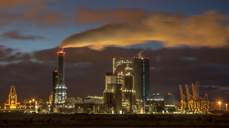 Coal powered power plant at night with illuminated smoke in Europoort, Maasvlakte Rotterdam