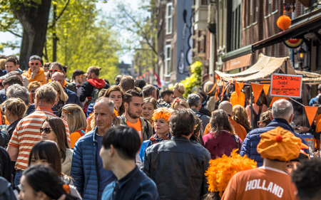 AMSTERDAM, THE NETHERLANDS - APRIL 27 2018: Crowd of people browsing on vrijmarkt flea market on annual Koningsdag. Birthday of the king. Editorial