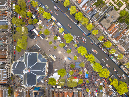 Market square Noordermarkt on Koningsdag Kings day festivities in Amsterdam. Birthday of the king. Seen from helicopter.