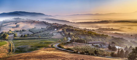 Tuscan foggy Village Landscape scenery near Florence on a Morning in august, Italy