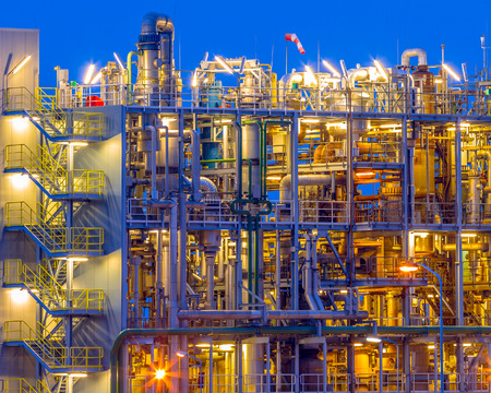 Detail of Heavy chemical plant vertical portrait in twilight in an industrial factory area