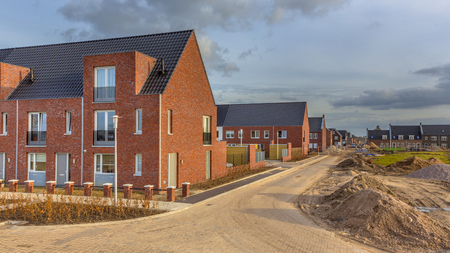Newly built houses in modern street building site in suburb of city in the Netherlands
