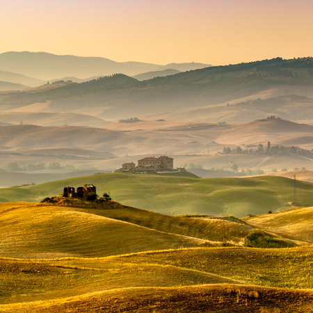 Sunrise over Farms in Hilly Countryside in Tuscany, Italy Reklamní fotografie