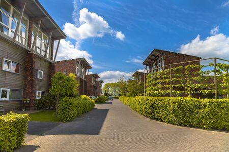 Modern street with large detached family houses in suburb in Groningen Netherlands Stock Photo