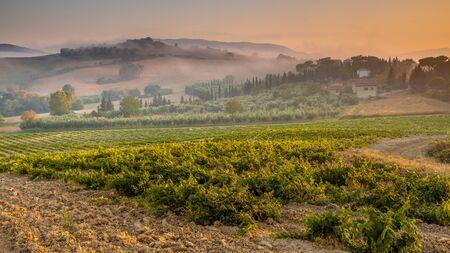 Tuscany Village Landscape near Florence on a Foggy Morning, Italy Stock Photo