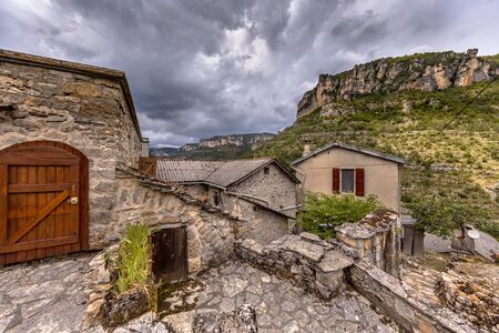 Village street scene with cobblestone houses with slate tile roofs in Le Rozier in Gorges du Tarn, Cevennes, France