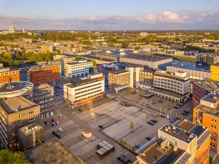 Commercial area in the Netherlands with office and bussiness building and parking lots