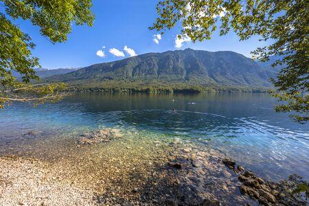 Turquoise water of Bohinjsko jezero or lake Bohinj seen from north coast on a sunny summer day near Bled, Slovenia 版權商用圖片