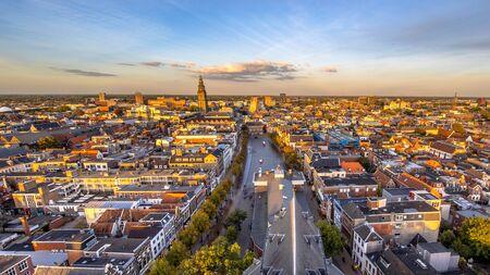 Aerial Skyline view of historic Groningen city centre at Vismarkt area under setting sun. The Netherlands Reklamní fotografie