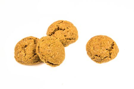 Set of four pepernoten cookies from above on white background for annual Sinterklaas holiday event in the Netherlands on december 5th