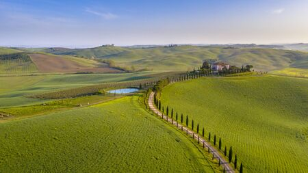 Aerial view of Hilly countryside of Tuscany in morning fog in Val d'orcia, Italy, April.