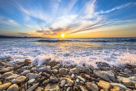 Waves of the Mediterranean sea breaking on pebble beach near Farinole Cap Corse, Corsica, France
