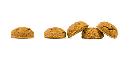 Pepernoten bunch of traditional cookies in a row on white background for annual Sinterklaas holiday event in the Netherlands on December 5th