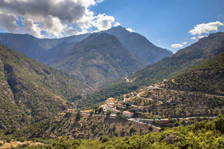 View on Asco village in Asco river gorge with view on Cinto mountain in Haute Corse on corsica island, France 免版税图像
