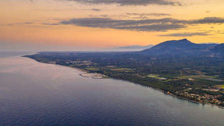 Aerial view of Corsica east coast seen from Moriani Plage at sunset, France