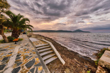 Boulevard with beach in small town of Gialova messinia on peloponnese peninsula in Greece