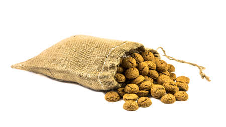 Traditional ginger nuts treats in jute bag on white background for annual Sinterklaas holiday event in the Netherlands on December 5th