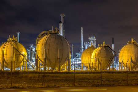 Industrial landscape with Harbor quay and loading cranes at night in Europoort Maasvlakte Port of Rotterdam Netherlands