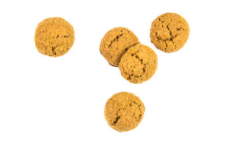 Group of five pepernoten cookies from above on white background for annual Sinterklaas holiday event in the Netherlands on december 5th Фото со стока