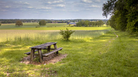 Agricultural landscape with picknick table seen from Bergherbos nature reserve