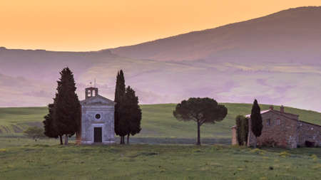 Chapel of Madonna in morning light in the hills of Tuscany, Italy, April.