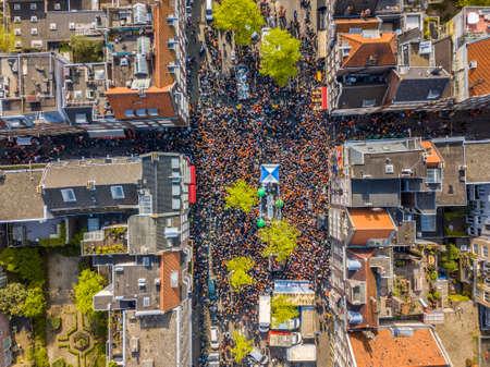 Aerial view of Huge crowd in Westerstraat on Koningsdag Kings day festivities in Amsterdam. Birthday of the king. Seen from helicopter.