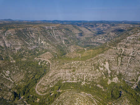 Aerial view of Gorges la Vis Valley cutting through Causse du Larzac in Cevennes National Park, Southern France