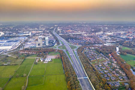Aerial view of Highway through city of Zwolle at sunset. Overijssel Province, the Netherlands.