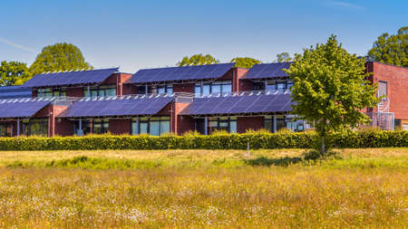 Public school building with solar panels utilized as sunlight protection. Shading the classrooms while generating electricity. A win-win situation. The Netherlands.