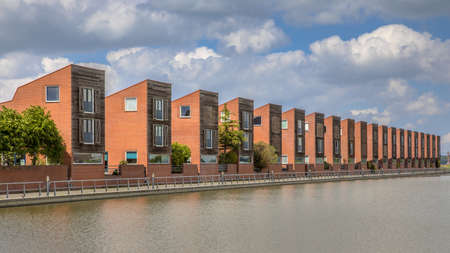 Modern detached family houses adjecent to water edge in suburb in Groningen Netherlands