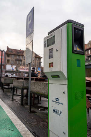 Katowice, Poland - February 7, 2020: Electric car charging station for public usage near main train station. Electric car parking lot with two places, green painted asphalt.