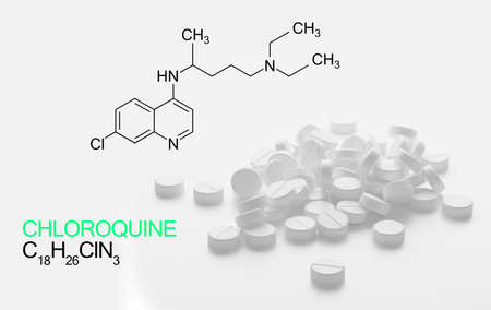 Chloroquini phosphas, chloroquine medicine substance. Drug introduced as treatment for coronavirus (SARS-CoV-2). Active in COVID-19 supportive therapy. Chemical formula written next to spilled pills Stock fotó