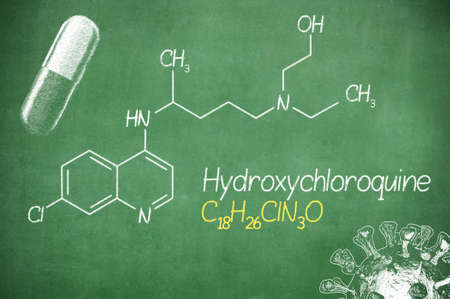 Hydroxychloroquine , chloroquine medicine substance. Drug introduced as treatment for coronavirus SARS-CoV-2. Active in COVID-19 supportive therapy. Chemical formula written with chalk on board. Stock fotó