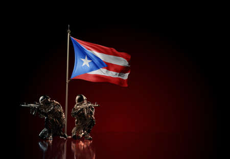Concept of military conflict with soldier statues and waving national flag of Puerto Rico. Illustration of coup idea. Two guards defending the symbol of country against red wall