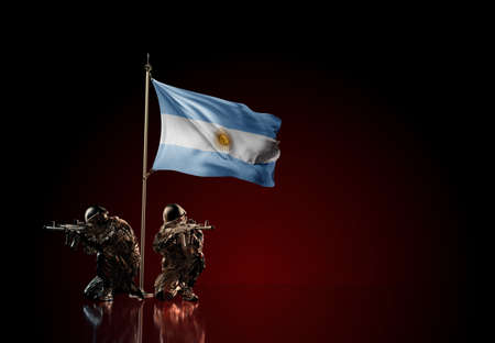 Concept of military conflict with soldier statues and waving national flag of Argentina. Illustration of coup idea. Two guards defending the symbol of country against red wall