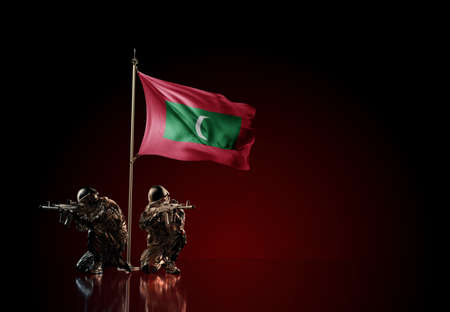 Concept of military conflict with soldier statues and waving national flag of MAldives. Illustration of coup idea. Two guards defending the symbol of country against red wall