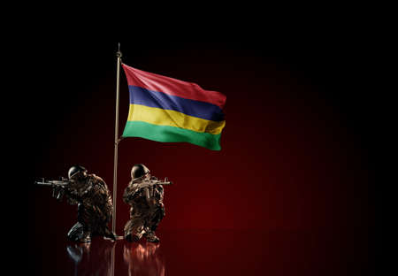 Concept of military conflict with soldier statues and waving national flag of Mauritius. Illustration of coup idea. Two guards defending the symbol of country against red wall