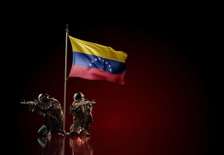Concept of military conflict with soldier statues and waving national flag of Venezuela. Illustration of coup idea. Two guards defending the symbol of country against red wall