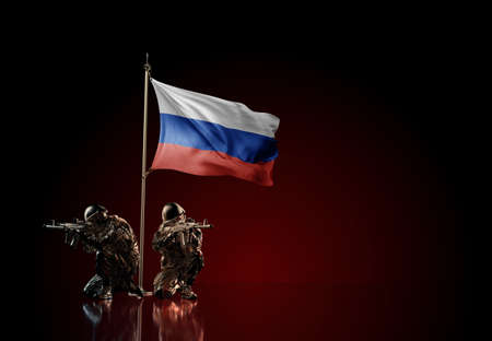 Concept of military conflict with soldier statues and waving national flag of Russia. Illustration of coup idea. Two guards defending the symbol of country against red wall