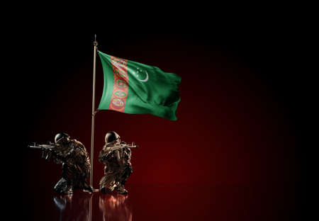 Concept of military conflict with soldier statues and waving national flag of Turkmenistan. Illustration of coup idea. Two guards defending the symbol of country against red wall