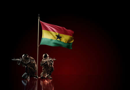 Concept of military conflict with soldier statues and waving national flag of Ghana. Illustration of coup idea. Two guards defending the symbol of country against red wall